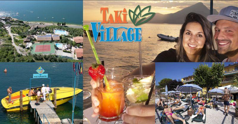 Pontile d'attracco sulla spiaggia privata - villaggio turistico Taki sul Lago di Garda con serv